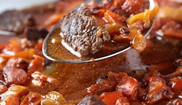Goulash with pepper in a frying pan